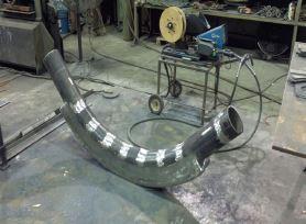 Tubo curvo para varredura de silos com filtros de manga e maior vida útil