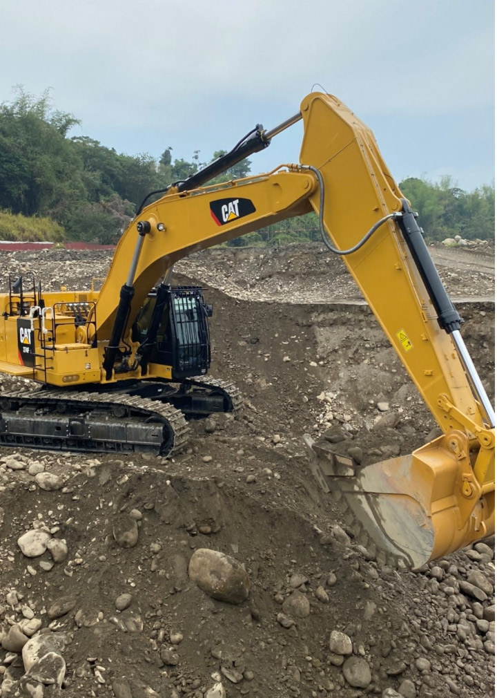 A yellow earthmoving attachment made in Hardox wear plate digging in the dirt