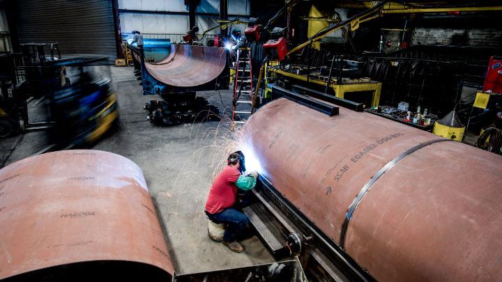 Welders in the workshop busily welding Hardox® 500 Tuf wear plate.