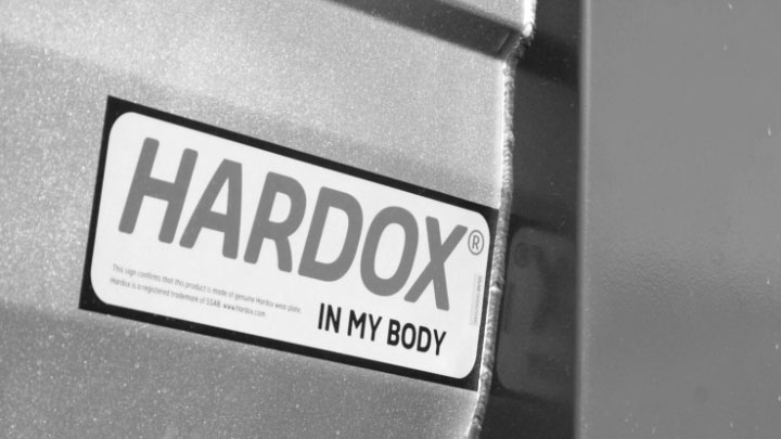 A close-up of the Hardox® In My Body logo on a dump body.