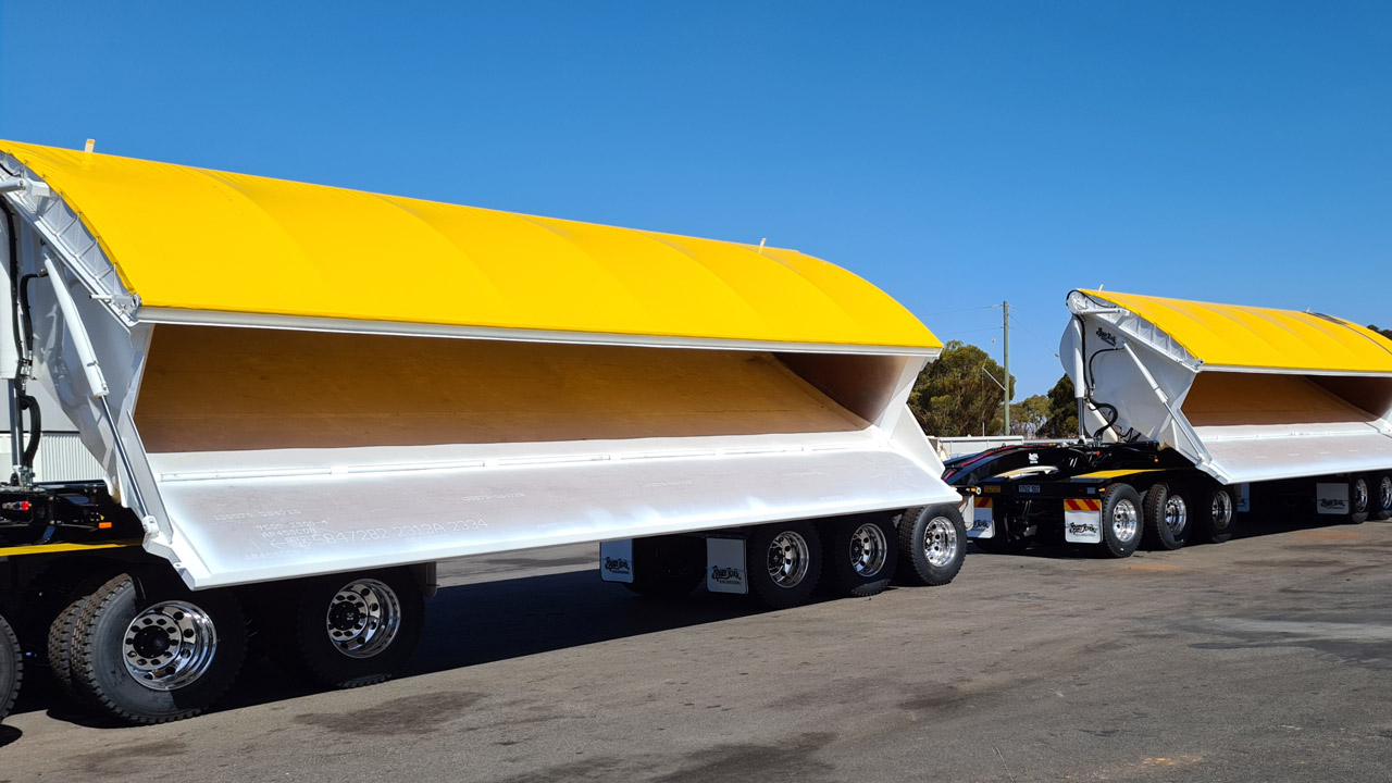 Enormous side dump trailer with yellow covers