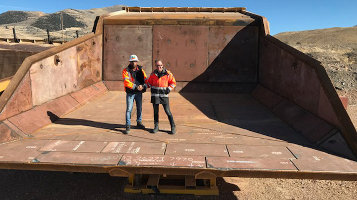 Two men agree that a huge truck liner will last longer with high grades of Hardox® wear plate.
