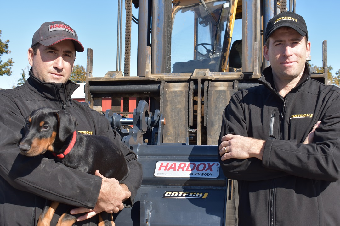 """Pictured with their pup named """"Hardox"""", brothers and co-owners of Cotech/X-metal, Etienne and Alexandre Côté, focus on a fast, first-to-market approach with innovative buckets."""