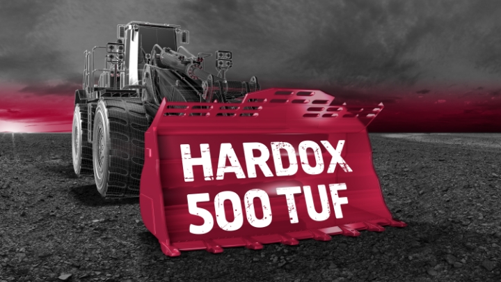 Hard and tough Hardox® 500 Tuf steel in a wheel loader bucket against a dramatic gray sky.