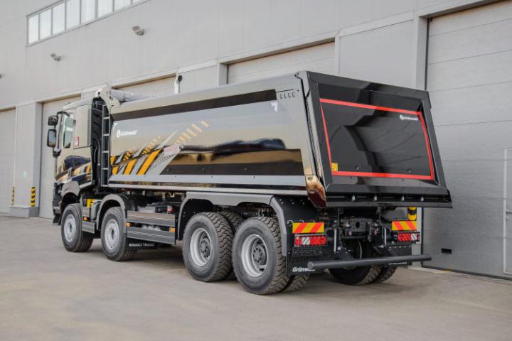 A silver rear-dumping rigid dump truck made in Hardox wear plate
