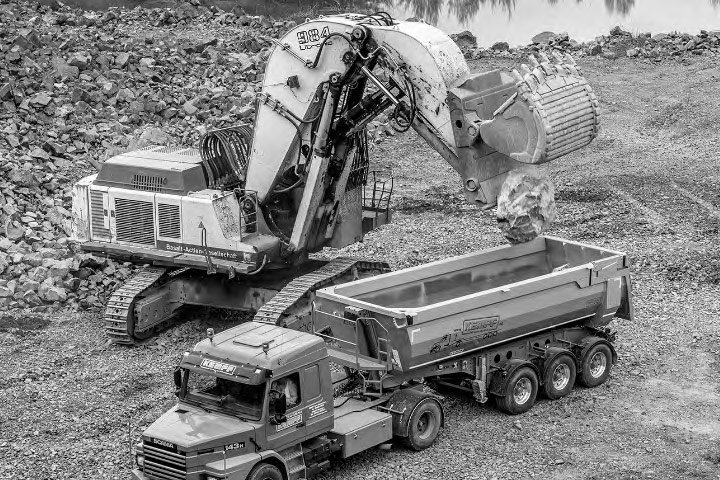 A digger loading into a truck body made in strong and tough Hardox® 450 steel