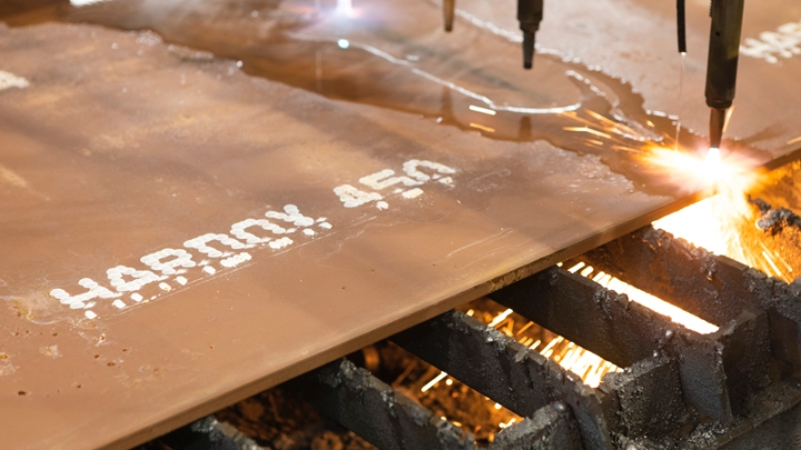 A genuine Hardox® wear plate being cut in a workshop.