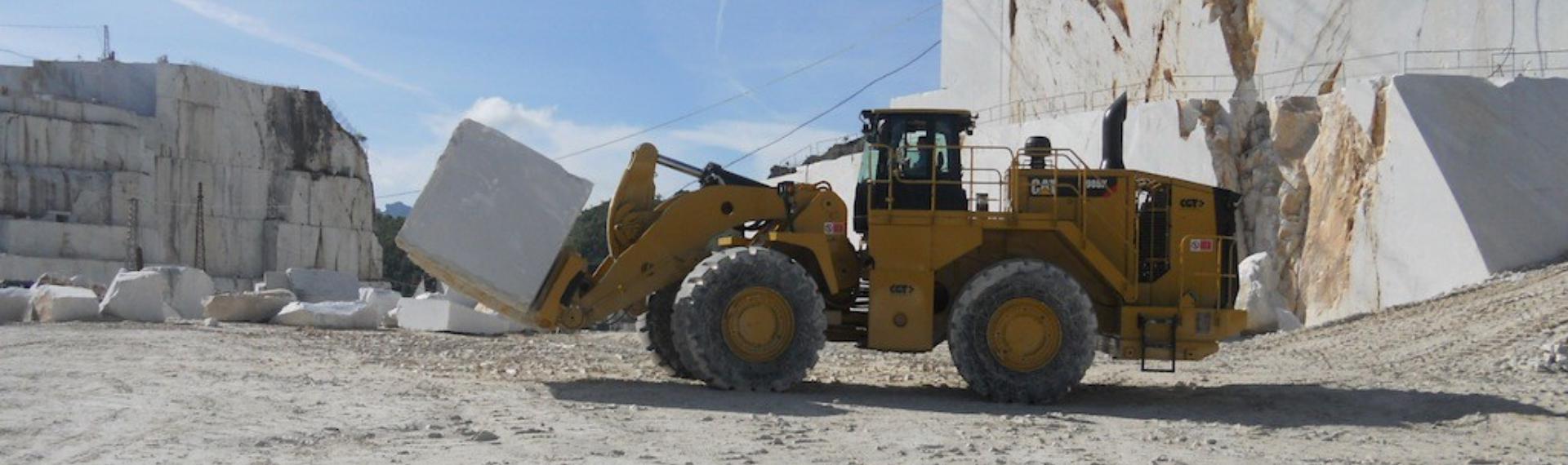 An enormous yellow excavator bucket made in Hardox® 450 steel.