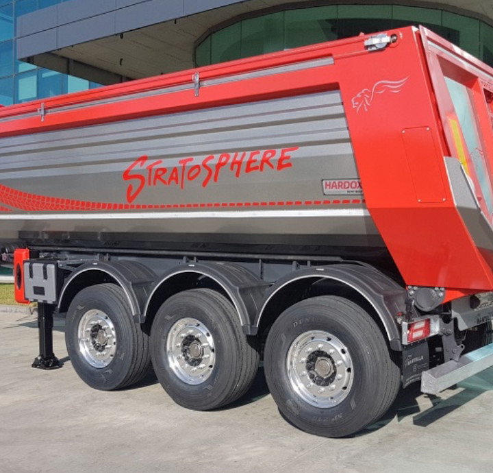 Close-up of a red Stratosphere tipper trailer showing the Hardox In My Body logo