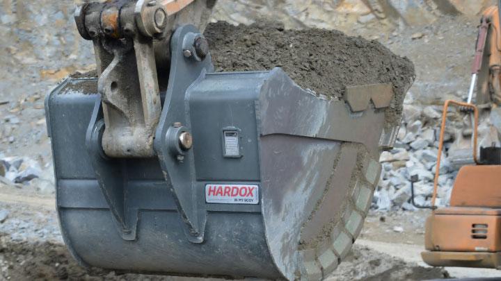 A huge mining bucket loaded with abrasive debris, made in Hardox® wear plate