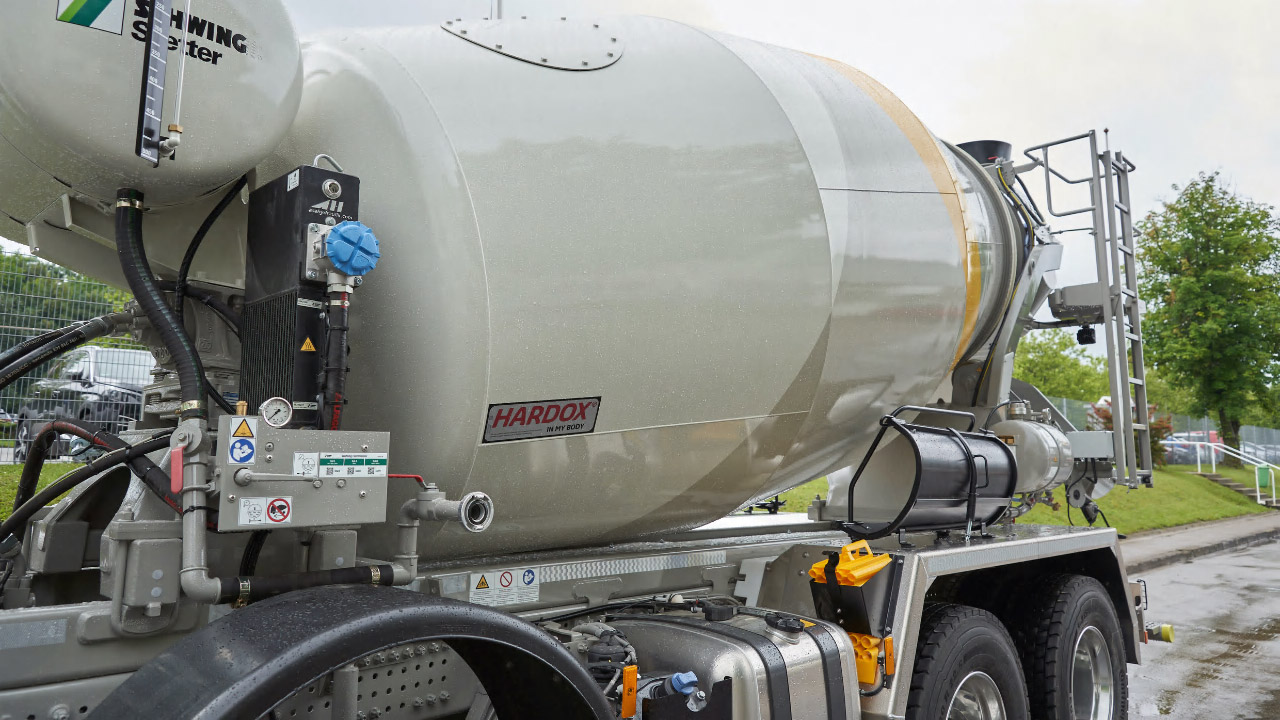 A white concrete mixer drum with the Hardox® In My Body logo.