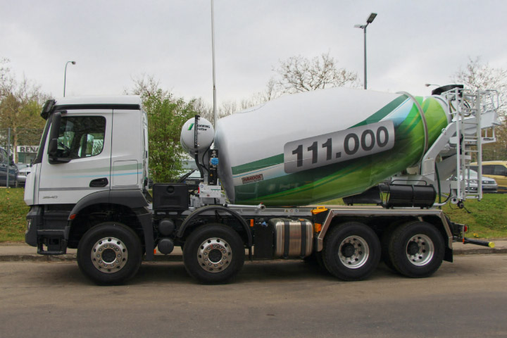 A concrete truck mixer with drum made in Hardox® wear steel on the road.