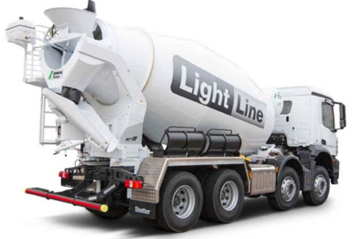 A concrete mixer truck in black and white, with mixer drum made in Hardox® wear steel.