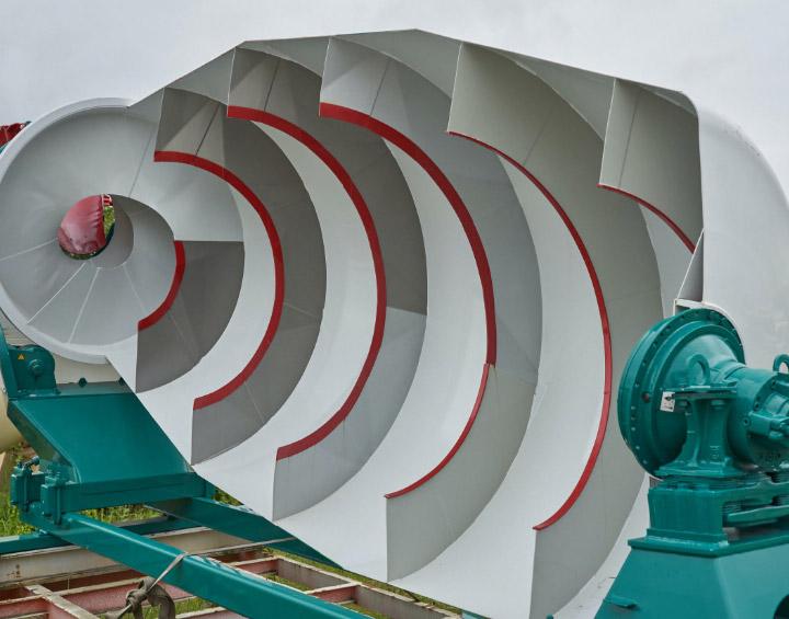 The inside of an enormous concrete mixer drum