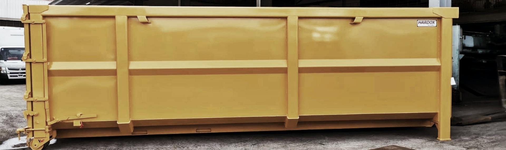A sleek yellow steel waste container built in Hardox® HiAce steel.