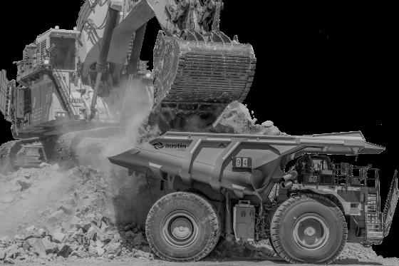 escavadeira e caminhão basculante