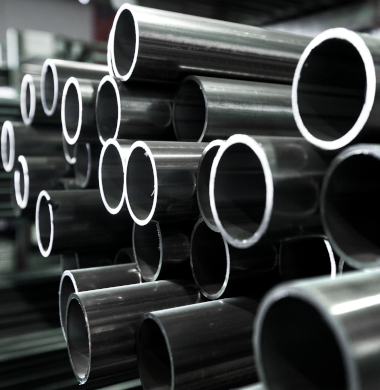 Abrasion resistant steel pipes and tubes