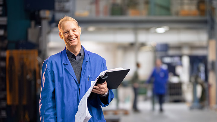 Man with folder in a working space