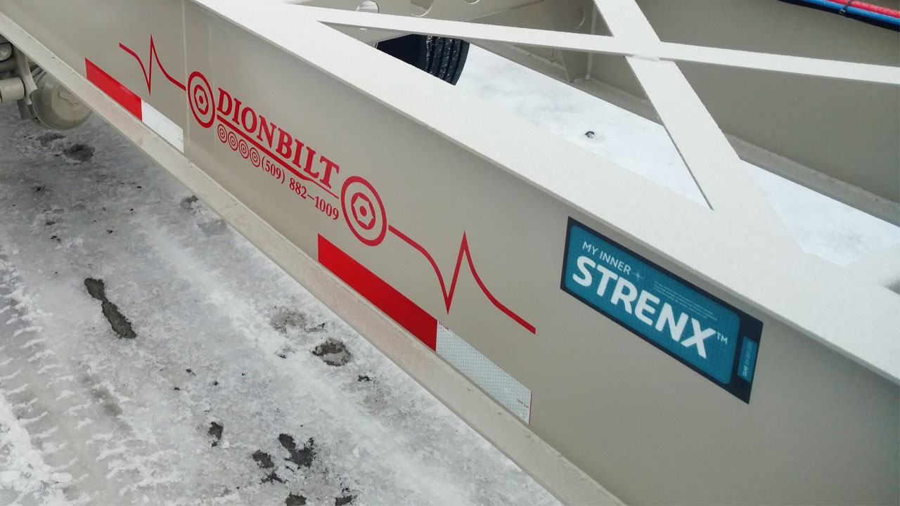 Close-up photo of a white trailer chassis beam with My Inner Strenx sign