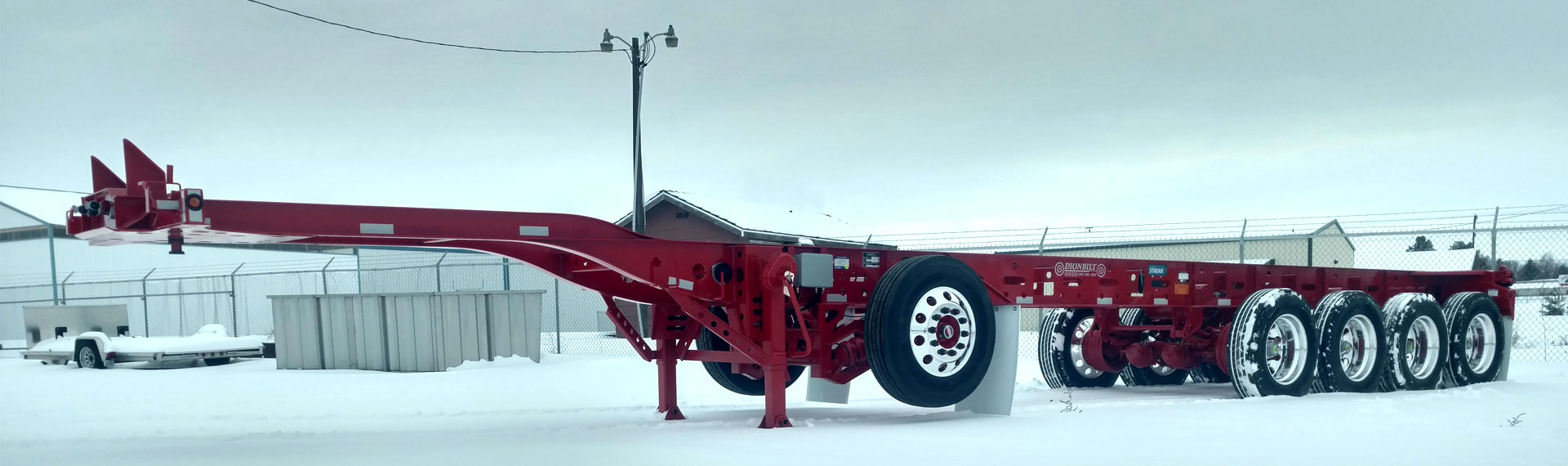 A long lightweight trailer chassis made with Strenx® 100 standing on snowy ground