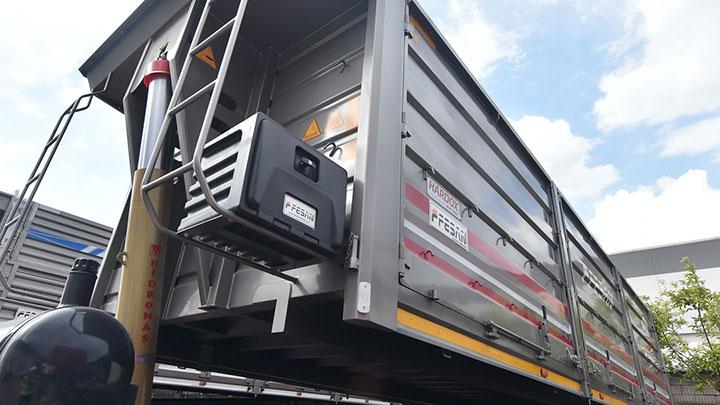 Back view of a shiny gray semitrailer dumper from Turkish company Fesan.