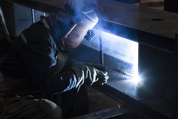 A welder welding high-strength Strenx® performance steel