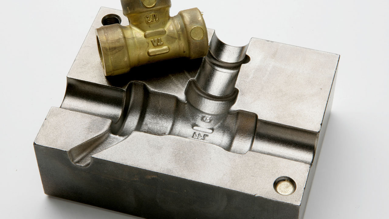 Steel die for casting a brass component